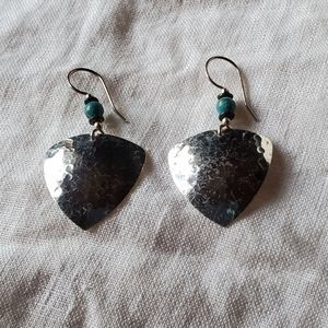 Silver toned earrings with bead